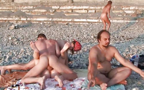 Naked old men on beach tell